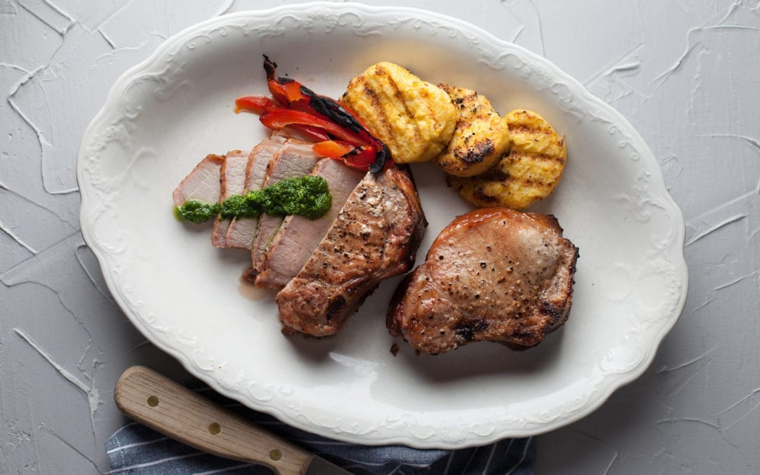 Oak Smoked Pork Chops with Arugula Pesto