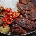 Cedar Planked Kalbi Marinated Steaks with Charred Onions